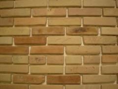 Tile for a front decor under a brick
