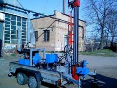 The hydraulic drilling rig on the two-axis trailer