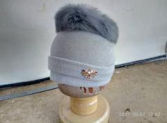 Knitted cap with fur of a rabbi