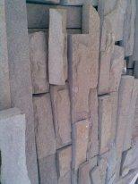 Tile facing a fragmentary stone, a tile a