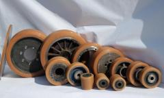 Wheels, rollers, bandages (covering polyurethane)