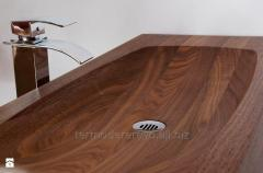 The wash basin is wooden elite, production of