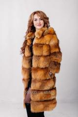 Fur coat from a fox a pyralid long with a hood a