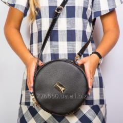 Round black handbag on a shoulder