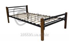 Metal single bed on wooden legs.