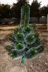 Artificial Christmas trees. A pine with effect of