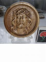 Icons are round carved, wooden on supports in