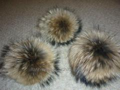 Pompons from natural fur of a raccoon