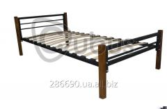 Metal single bed on wooden legs.