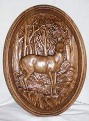 Souvenir products from a tree, carved pictures to