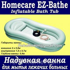 Inflatable bathtub for washing of bed patients of