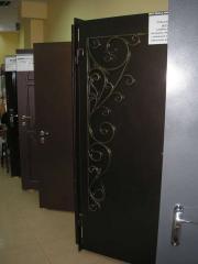 Двери бронированные с элементами ковки в