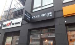 La placa para la tienda Vape House Shop