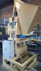 The machine for production of the pressed brick