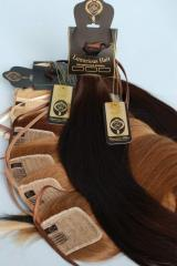 Chignon tail on a tape from natural hair