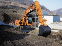 La excavadora Doosan DX210W de rueda