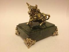 The figure is bronze, the Taurus, zodiac sign, a