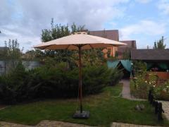 Classical wooden umbrella of a premium class