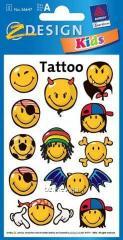 Татуировка с изображениями смайликов