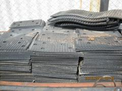 Rubber laying for wooden ties