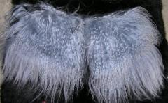 Pockets from fur of a lama in gray color