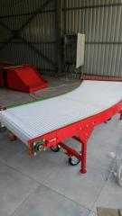 The rotary conveyor with a modular tape