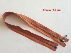 The lightning metal YKK, the size No. 5, is long - 50 cm, a band - red, color of teeths - an antique, the article of CK 5160