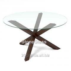 Glass table with the basis from the massif of a