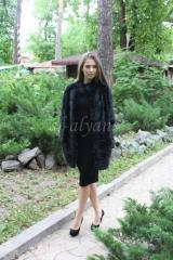 Fur coat from a muskrat of a cross cut of...