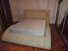 Stylish leather bed of Irena with the lifting