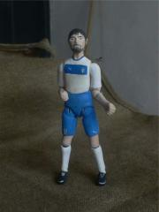 Author's porcelain doll football player