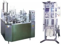 Automatic machines for packing in glasses and