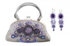 Leather handbag with beadwork and natural stones