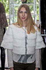 Fur cape on shoulders from a white mink
