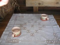 Little handmade tablecloth on the coffee table