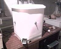 Masina-unelta pentru curatare de pene de pasari