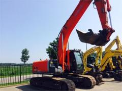 Caterpillar Hitachi ZX210LC excavator.