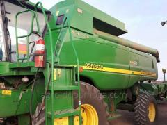 The combine John Deere 9560 STS bu with a...