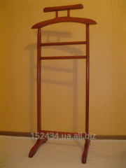 Floor wooden unary hanger for clothes.
