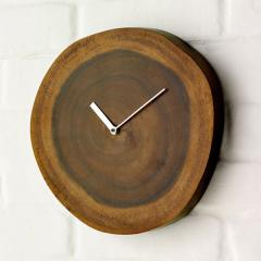 Wall clock in eko style from a natural tree under