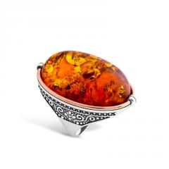 Ring with amber, 409