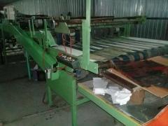 Bag making machine for producing bags -