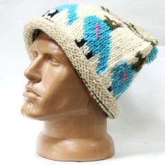 Шерстяная шапка вязаная светлая узор птица помпон