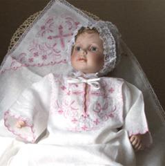 Baptismal set for the girl: a bed-sheet with a