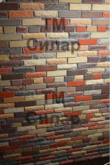 Brick front facing of a shell rock