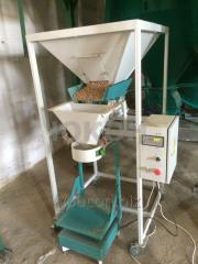 Packing of the granules. semi-automatic dispenser