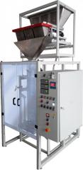 Automatic machine for the packing of bulk products