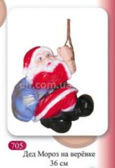 Garden figure of Santa Claus on rope