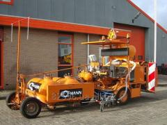 Road-servicing machinery