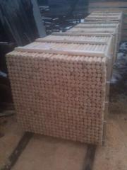 Wooden stakes for the garden of conifers from